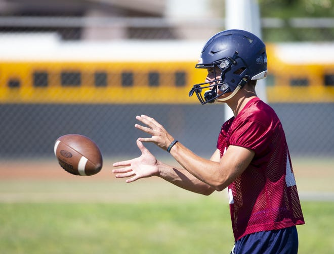 Perry High football quarterback Chubba Purdy, (12) runs a play during practice in Gilbert on September 26,  2018.