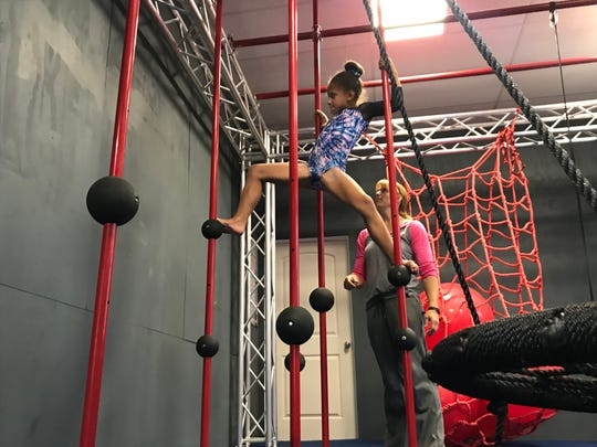 Nevaeh Brown of All-American Flames completes a station at the Fuse Ninja Gym.