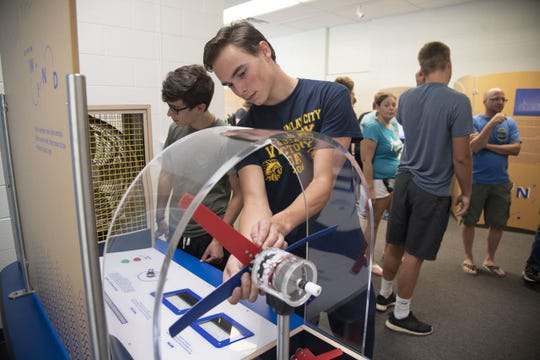 Students check out interactive science exhibits in SC4's Experience Center.