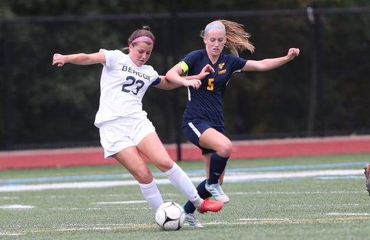 From left, Beacon's Analiese Compagnone (23) and Lourdes'  Maeve Connolly (5) battle for ball control during a girls soccer game at Our Lady of Lourdes in Poughkeepsie Sept. 26, 2018. They played to a 0-0 tie.