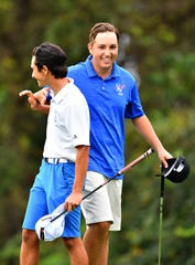 Dallastown's Michael DeRose, left, congratulates Spring Grove's Karl Frisk following Frisk's win during a sudden-death playoff for second place during Thursday's York-Adams League Individual Golf Championship at Briarwood East Golf Club. Dawn J. Sagert photo