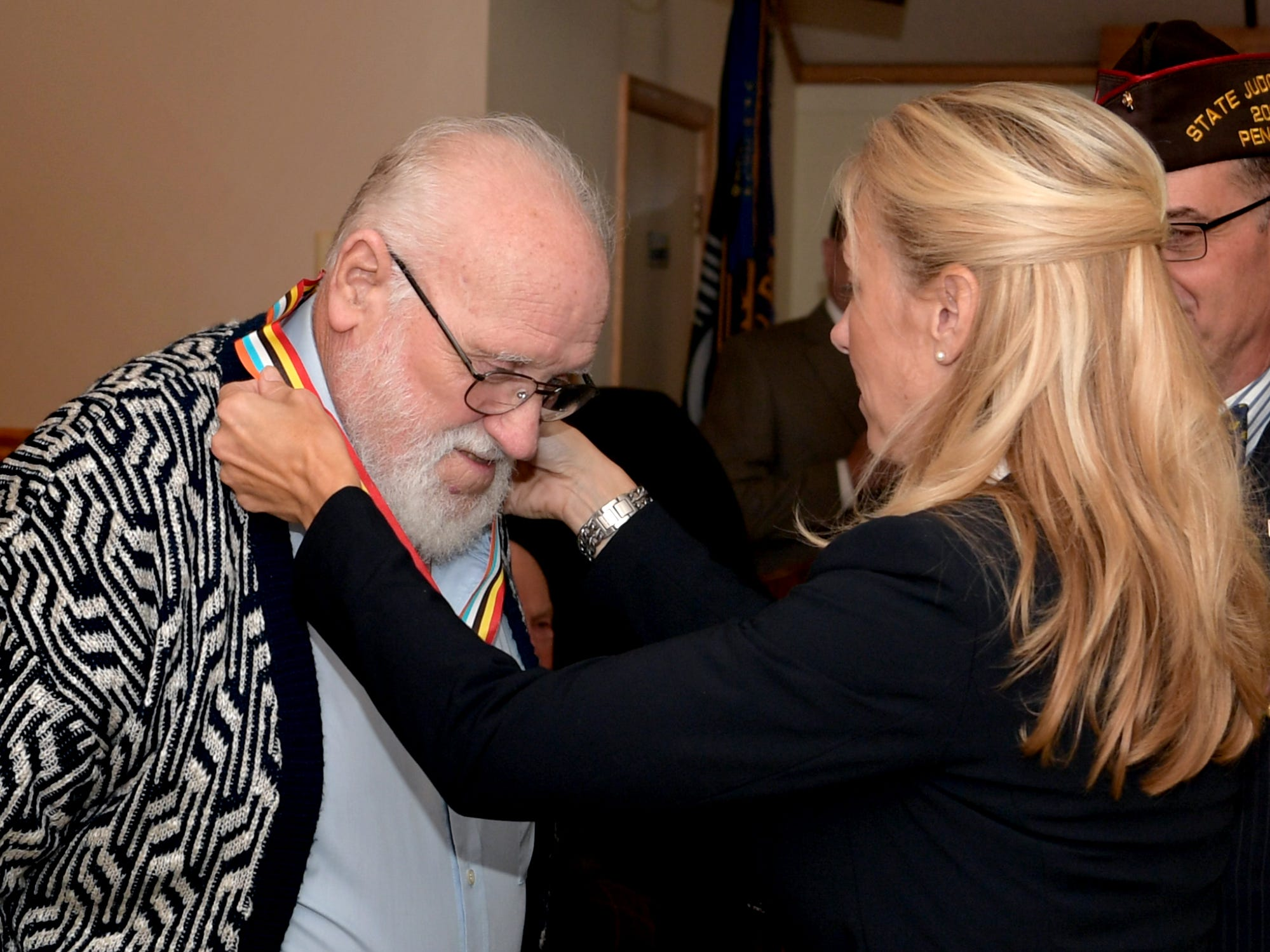 Korean War veteran Earl Hanshaw of Dillsburg receives an Ambassador for Peace Medal from PA State Representative Dawn Keefer during a ceremony at the James A. Danner VFW Post #537 in Newberry Township Thursday, Sept. 27, 2018. Hanshaw and five other Korean War veterans received the medals, issued by the Korean government, during the event. Keefer sponsored the event in conjunction with U.S. Senator Pat Toomey's office, which assisted in procuring the medals. Bill Kalina photo