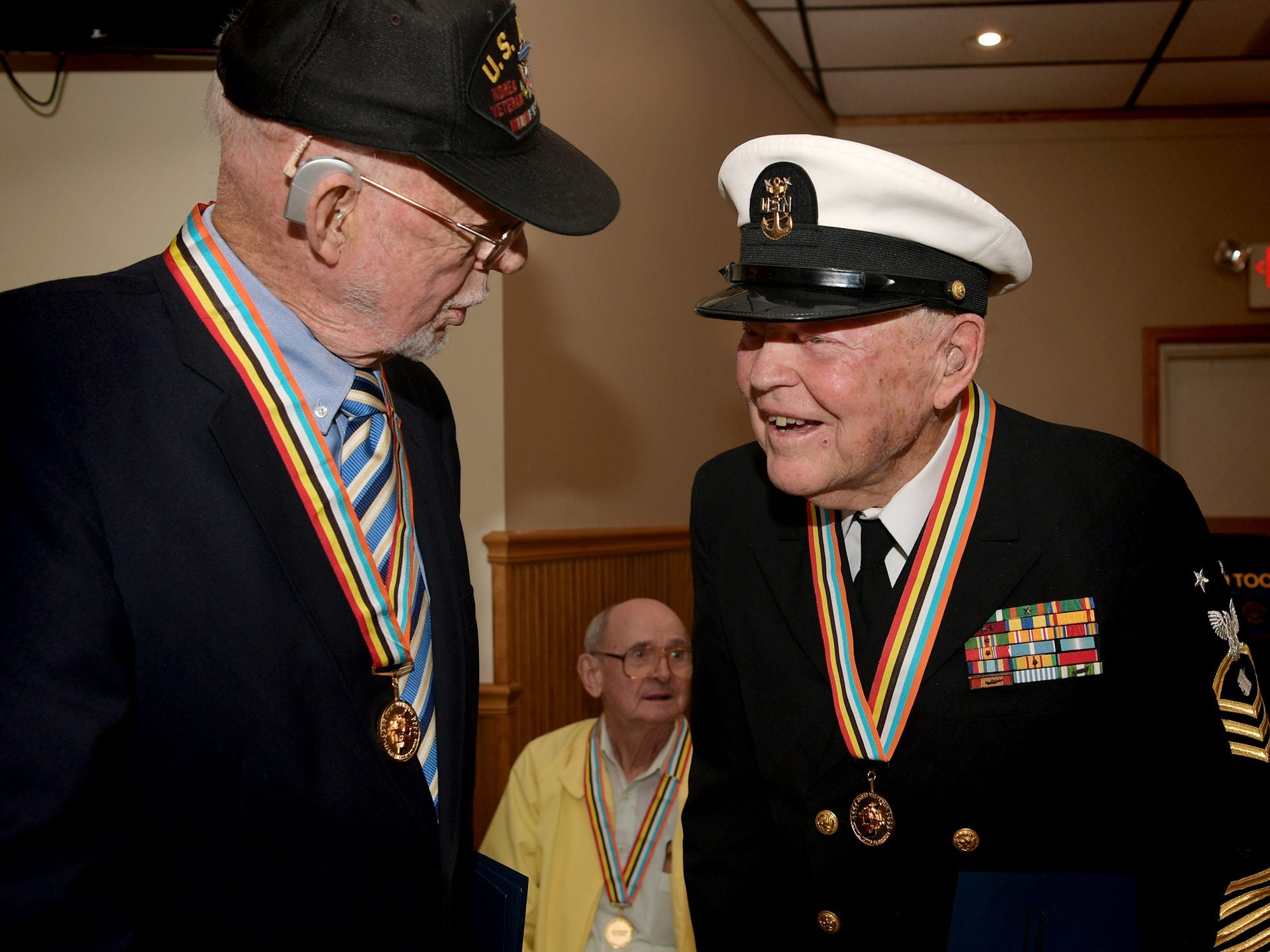 Area Korean War veterans Hal Anderson and Harrison McCann, left, both of Dillsburg, talk after receiving Ambassador for Peace Medals issued by the Korean government during a ceremony at the James A. Danner VFW Post #537 in Newberry Township Thursday, Sept. 27, 2018. The event was sponsored by PA State Representative Dawn Keefer in conjunction with U.S. Senator Pat Toomey's office, which assisted in procuring the medals. Bill Kalina photo