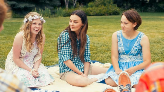 """Elise Jones as Amy, Melanie Stone as Meg and Allie Jennings as Beth in the movie """"Little Women."""" The movie is playing at Regal West Manchester Stadium 13,"""