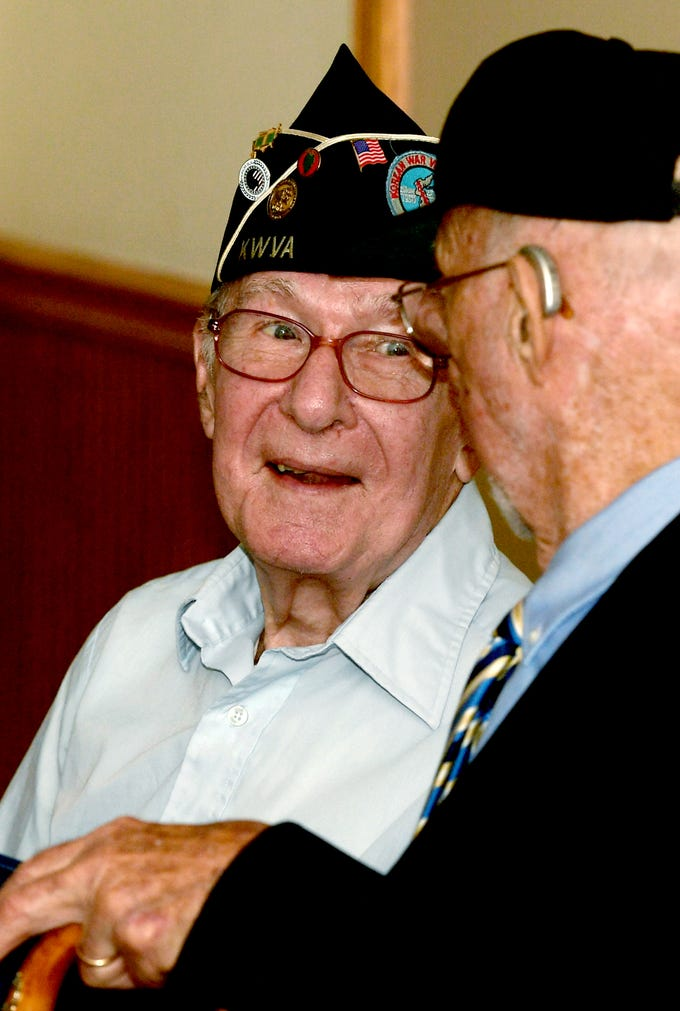 Korean War veteran Victor Aldinger, left, of Newberry Township talks with fellow veteran Hal Anderson of Dillsburg during a ceremony at the James A. Danner VFW Post #537 in Newberry Township Thursday, Sept. 27, 2018. The pair and four other Korean War veterans received Ambassador for Peace Medals, issued by the Korean government, during the event. PA State Representative Dawn Keefer sponsored the event in conjunction with U.S. Senator Pat Toomey's office, which assisted in procuring the medals. Bill Kalina photo