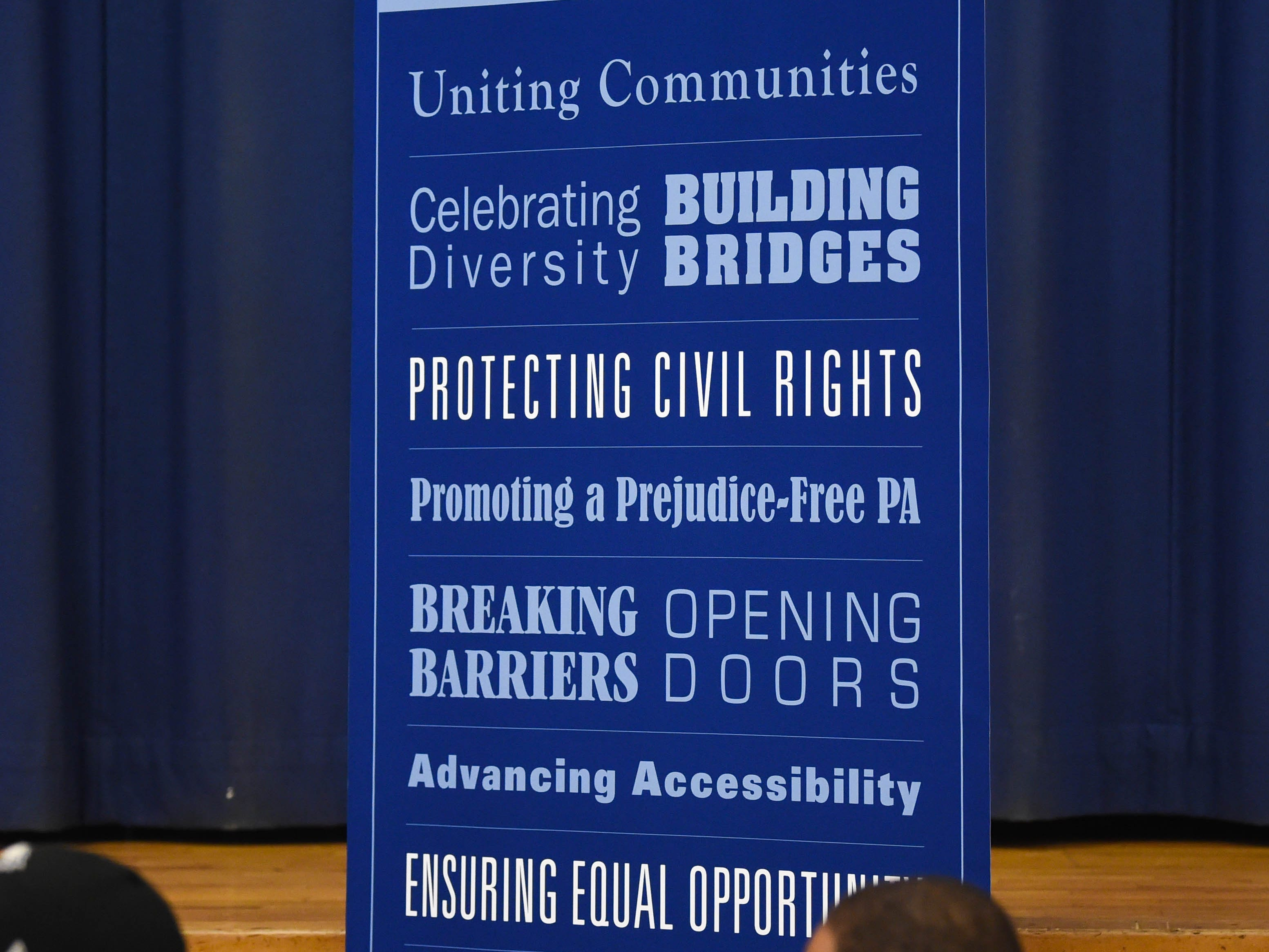 """The Pennsylvania Human Relations Commission put up signs describing their goals during the """"No Hate in Our State"""" Social Justice Town Hall meeting at the Crispus Attucks Community Center, Wednesday, September 26, 2018."""