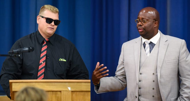 "Chad Dion Lassiter, executive director of the Pa. Human Relations Commission, right, defends the right to speak by a man claiming to represent the Ku Klux Klan, left, during the ""No Hate in Our State"" Social Justice Town Hall meeting at the Crispus Attucks Community Center on Wednesday."