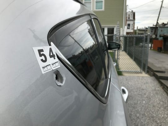 Detectives found a bullet hole in a car across the alley near the 600 block of West Princess Street, York, where two males were shot to death Wednesday night.