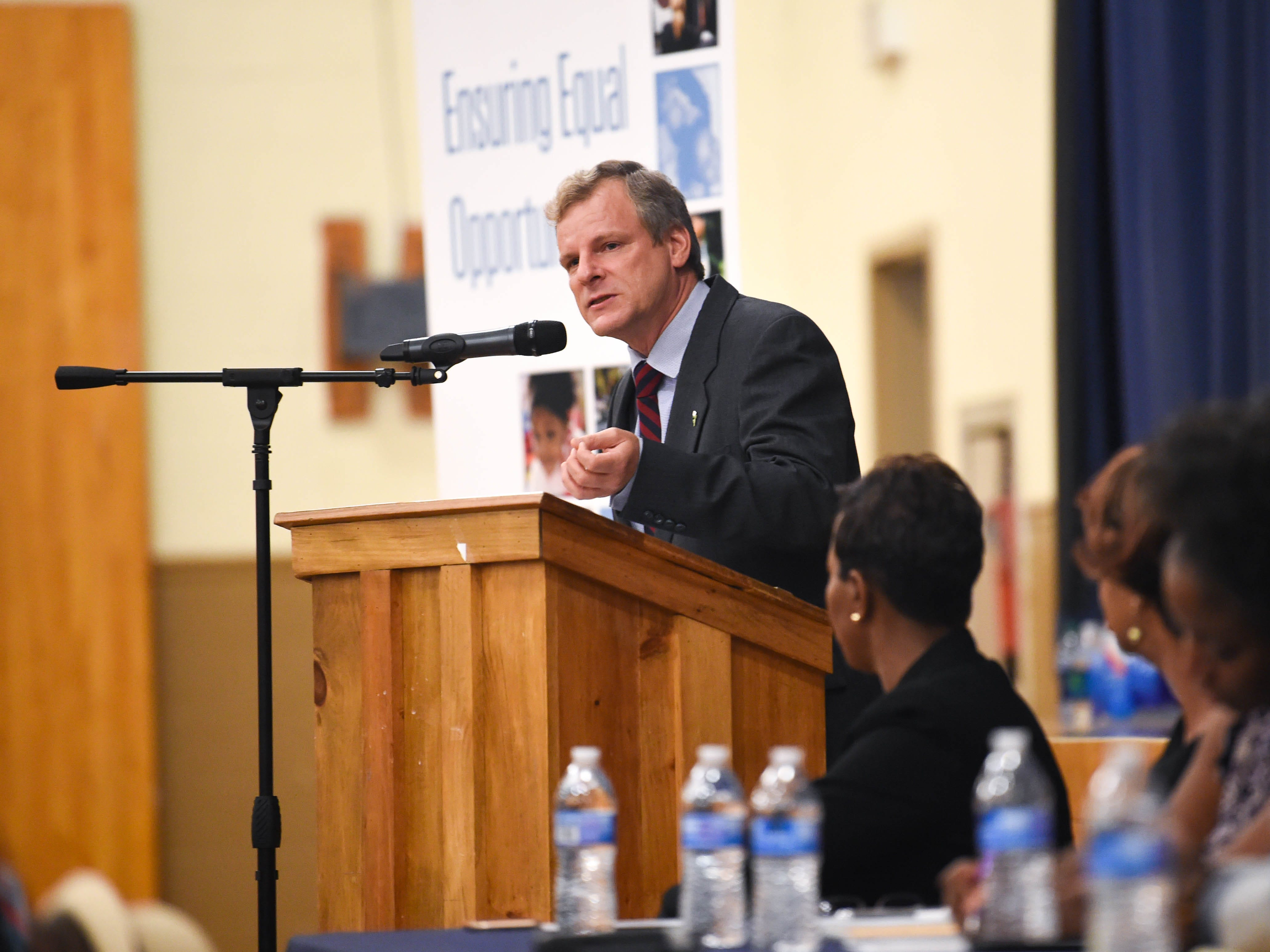 """Mayor Michael Helfrich greets the crowd during the """"No Hate in Our State"""" Social Justice Town Hall meeting at the Crispus Attucks Community Center, Wednesday, September 26, 2018."""