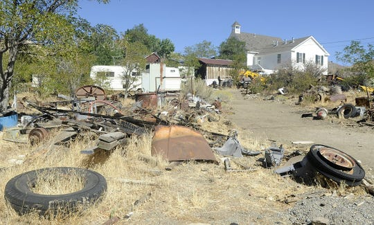 Garbage covers a property in Silver City.