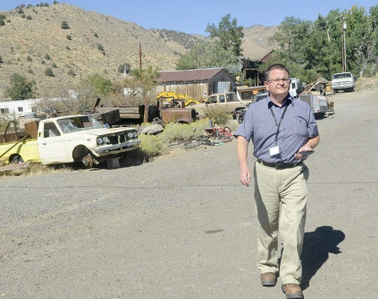 Lyon County Code Compliance Officer David Scott walks through Silver City looking at several properties that were reported to him.