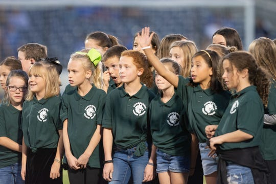 Children from Hunsberger Elementary sing the National Anthem before theReno 1868 FC's USL match against Rio Grande Valley FC on Wednesday,