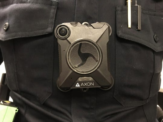 An Axon body worn camera attached to the chest of a Reno police officer.