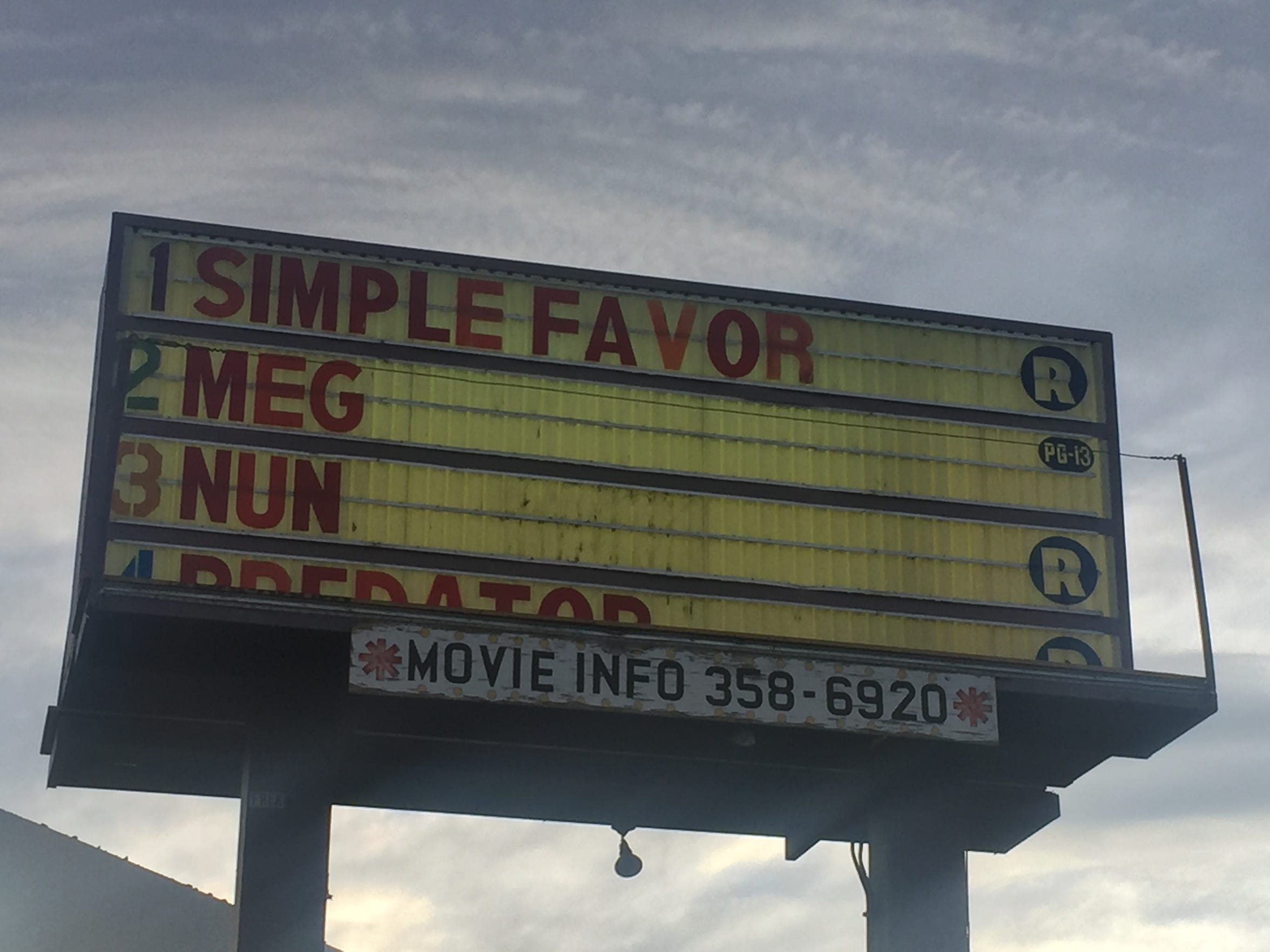 The golden marquee at the West Wind El Rancho 4 Drive-in in Sparks displays the movies showing on Sept. 14, 2018.