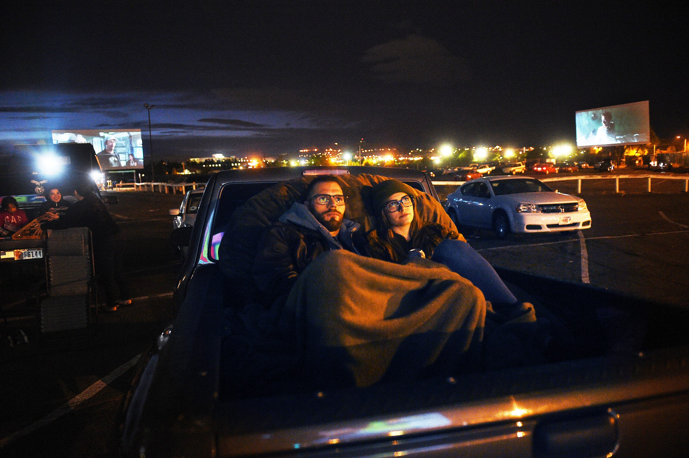 Taylor Sexton and Caroline McDermaid sit comfortably on a bean bag in their trucks' bed while watching the new Predator film at the West Wind El Rancho Drive-In 4 movie theater in Sparks on Sept. 14, 2018.