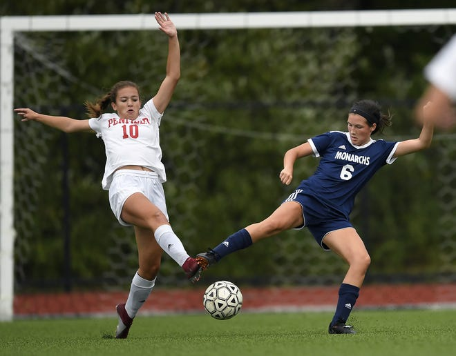 Penfield's Rebecca Rolland, left, and Mercy's Kari Schoen reach for the ball during a game at Mercy on Wednesday. Mercy won 1-0.