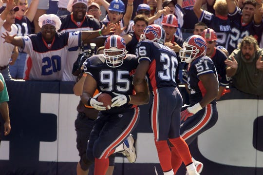 Sam Adams' interception return touchdown helped the Bills stun the Patriots on opening day in 2003.