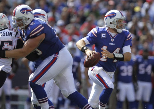 Bills quarterback Ryan Fitzpatrick scrambles out of the pocket and upfield against the Patriots in 2011.