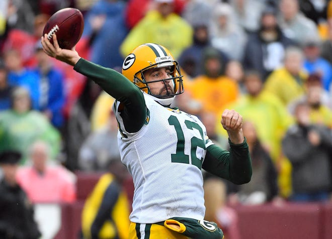 Green Bay Packers quarterback Aaron Rodgers (12) attempts a pass against the Washington Redskins during the second half at FedEx Field.