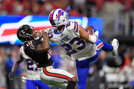 Buffalo Bills strong safety Micah Hyde intercepts a pass intended for Atlanta Falcons wide receiver Taylor Gabriel.