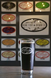 A pint of Stayin' On the Grind Coffee Stout at the new Rising Storm Brewing in Livonia Thursday, Sept. 27, 2018.