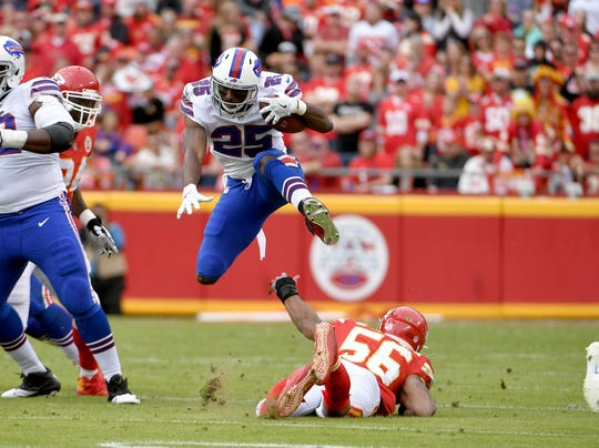 Buffalo Bills running back LeSean McCoy (25) leaps over Chiefs inside linebacker Derrick Johnson (56) on a run during the first half last season in Kansas City.