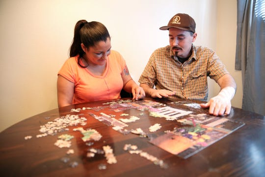 Matthew Boyd and Cassandra DeBeck are pictured in their Keizer home on Wednesday, Sept. 26, 2018. The couple plans to hang up puzzles they put together up on the walls of their new home.