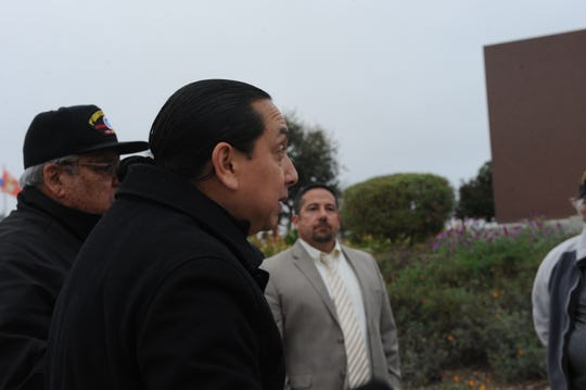 Aurelio Salazar Jr. expressed concerns about the site of a proposed homeless shelter in central Salinas. Behind him to the left is former supervisor Fernando Armenta, and Superintendent Dan Burns stands in the background.