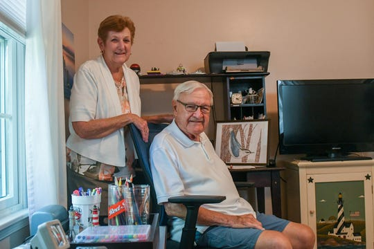 Chuck and Betty Jane Ertel pose with some of Chuck's artwork in their Ocean Pines home on Wednesday, Sept 26, 2018.