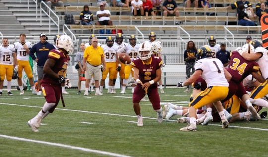 Jack Navitsky pitches the ball to one of his slot backs during a Salisbury University football game.