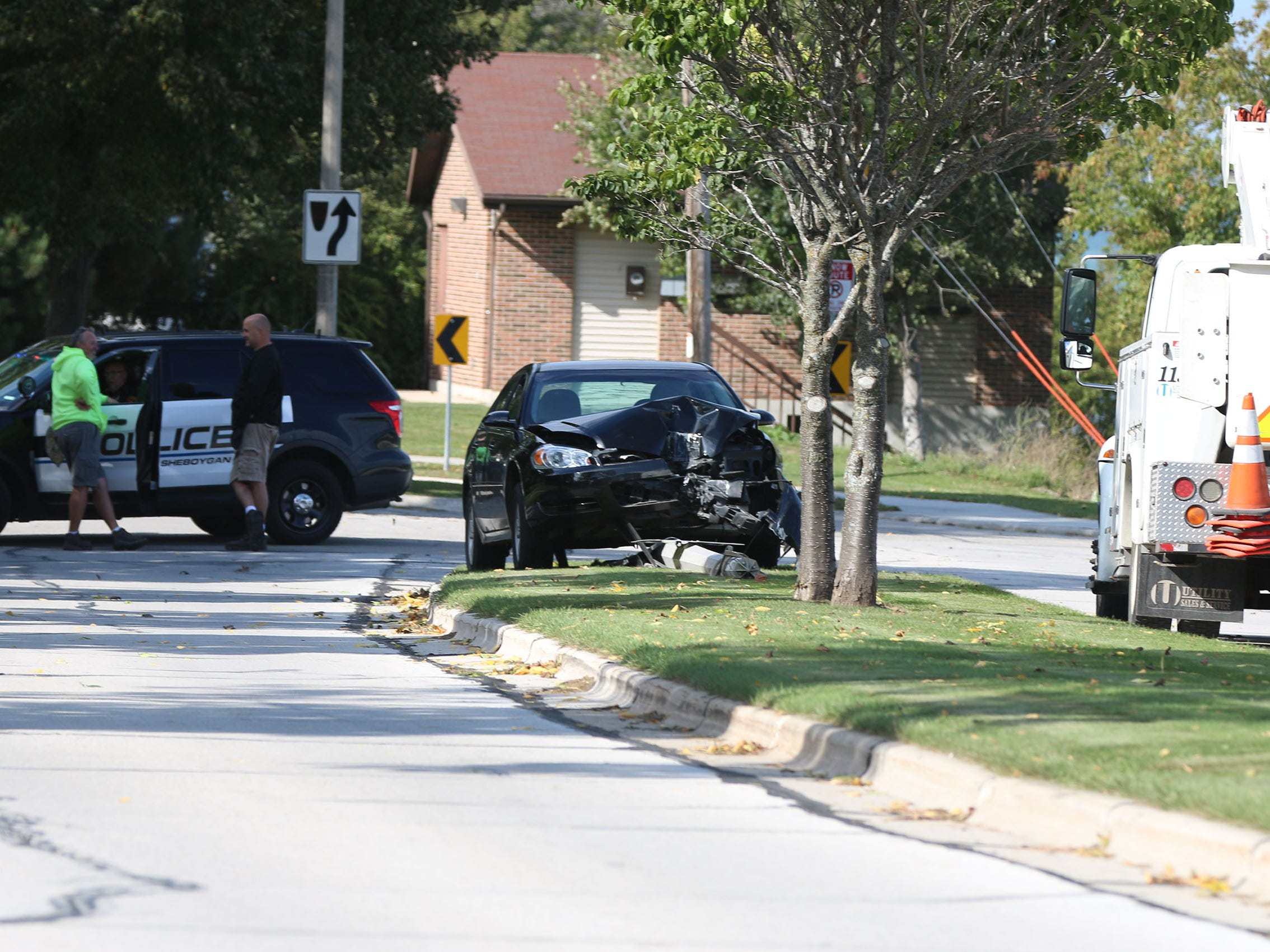 The front end of a car sustained damage when it hit a light pole, Thursday, September 27, 2018, in Sheboygan, Wis. The drivers side air bag deployed but there was no mention if there were injuries.  City of Sheboygan Police and Public Works employees were at the scene.