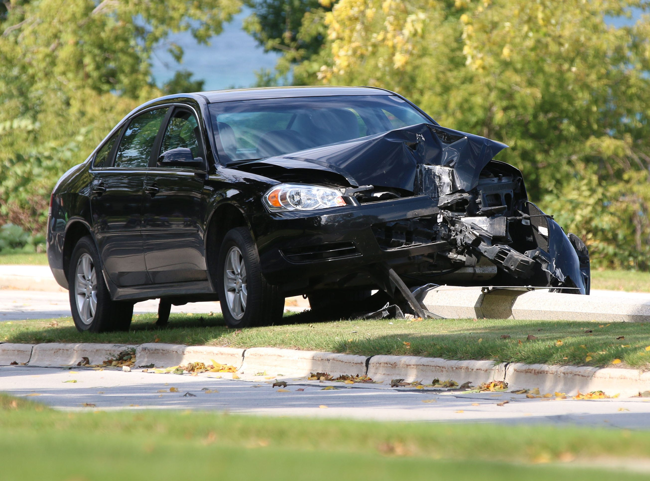 The front end of a car sustained damage when it hit a light pole, Thursday, September 27, 2018, in Sheboygan, Wis. The drivers side air bag deployed but there was no mention if there were injuries.
