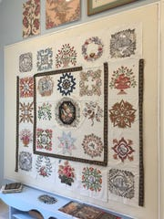 Hanging on the wall of her quilting/TV room in Springfield is an unfinished design that Suzanne Louth is still in the process of creating. It demonstrates her broderie perse technique of appliquéing various motifs onto a sold fabric.