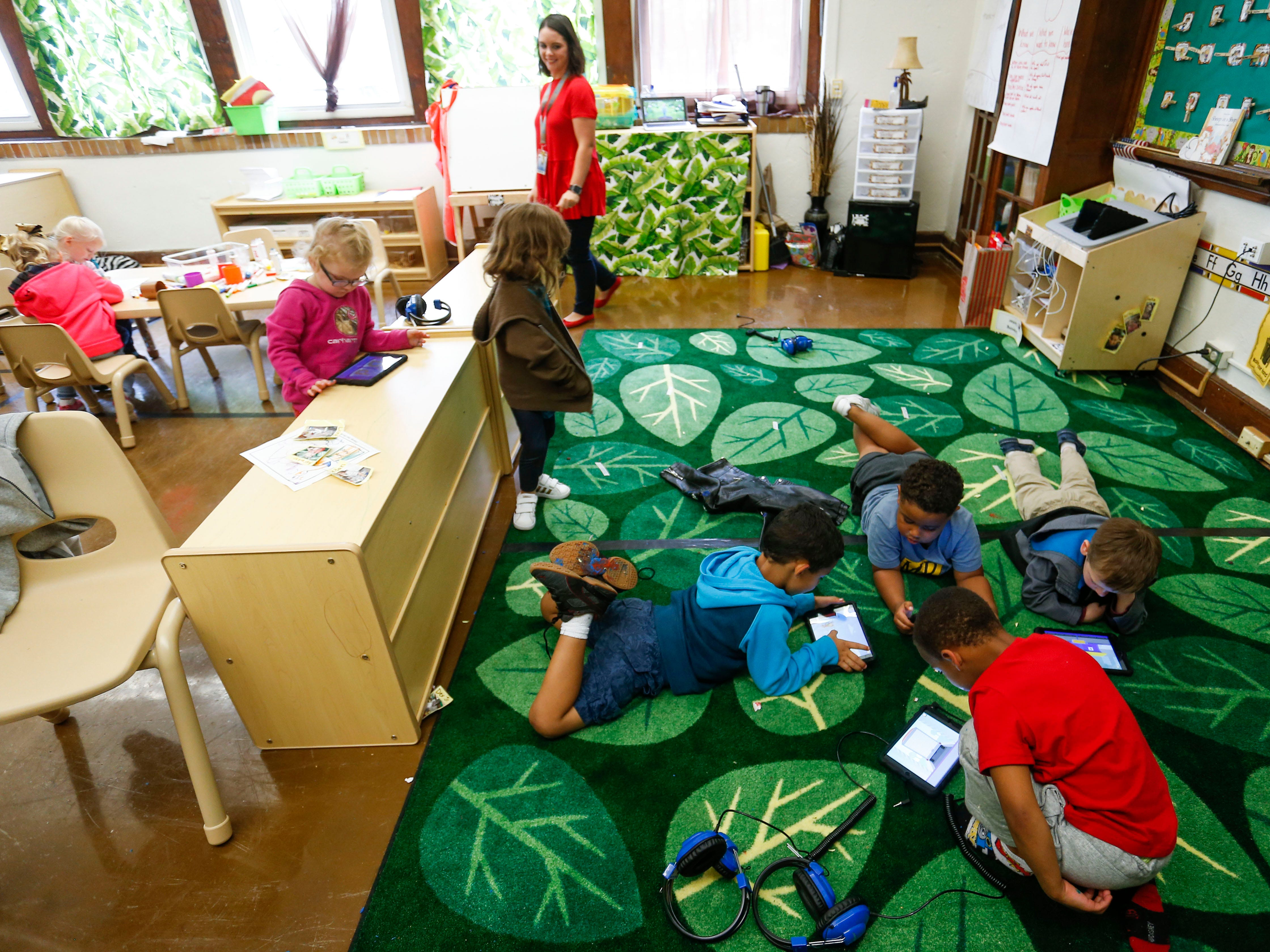 Children use tablets in a preschool classroom at the new Campbell Early Childhood Center on Thursday, Sept. 26, 2018.