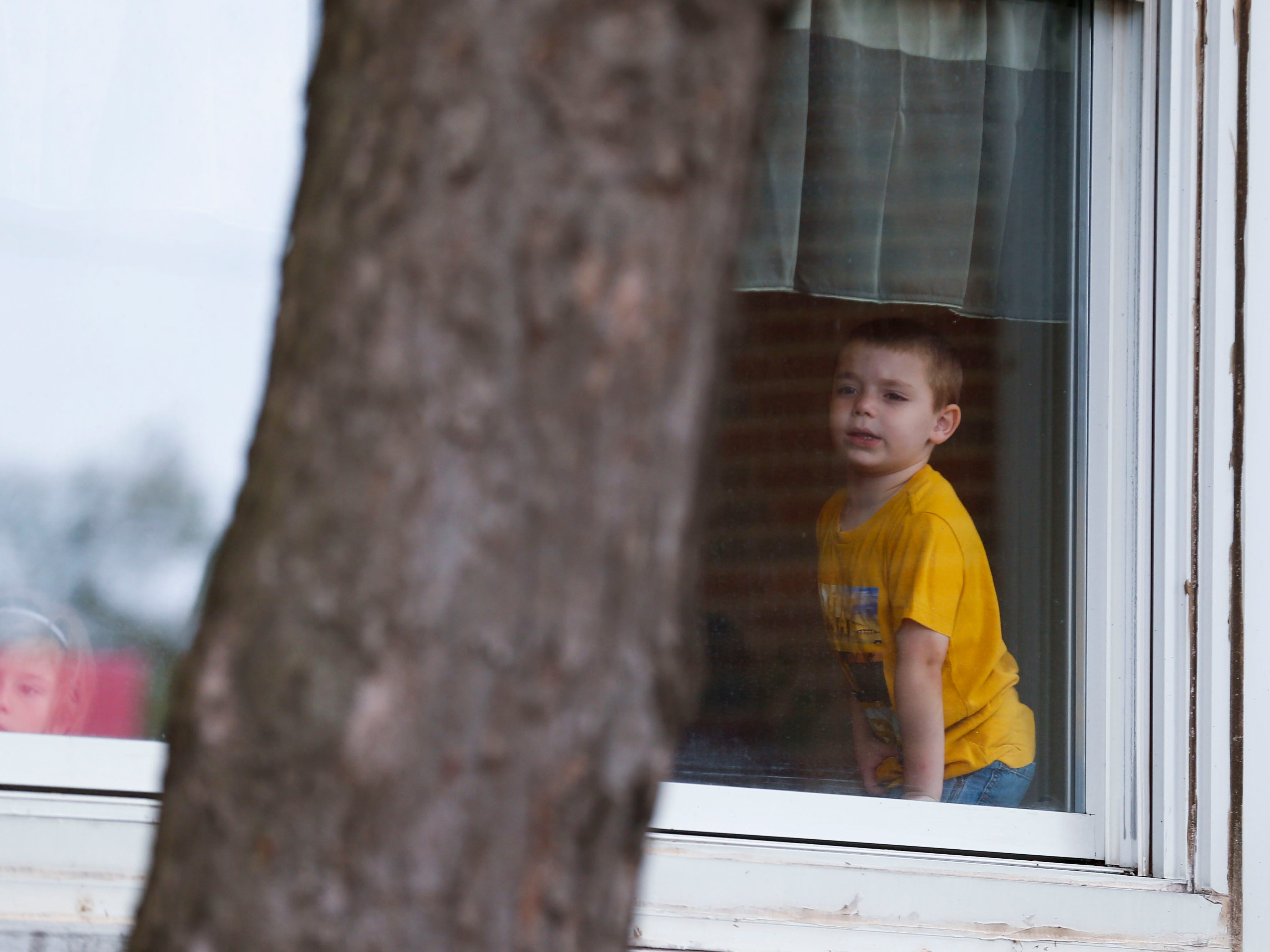 A child looks out the window of the Campbell Early Childhood Center at a ribbon cutting ceremony for the center on Thursday, Sept. 26, 2018.