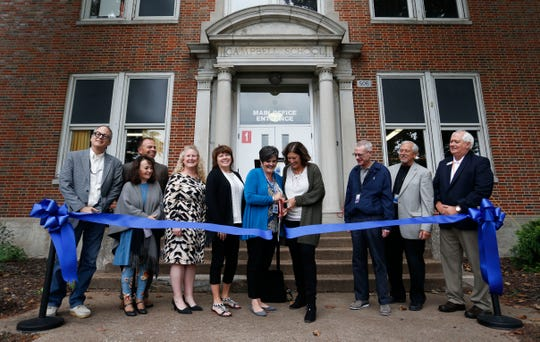School officials cut a ribbon for the new Campbell Early Childhood Center on Thursday, Sept. 26, 2018.