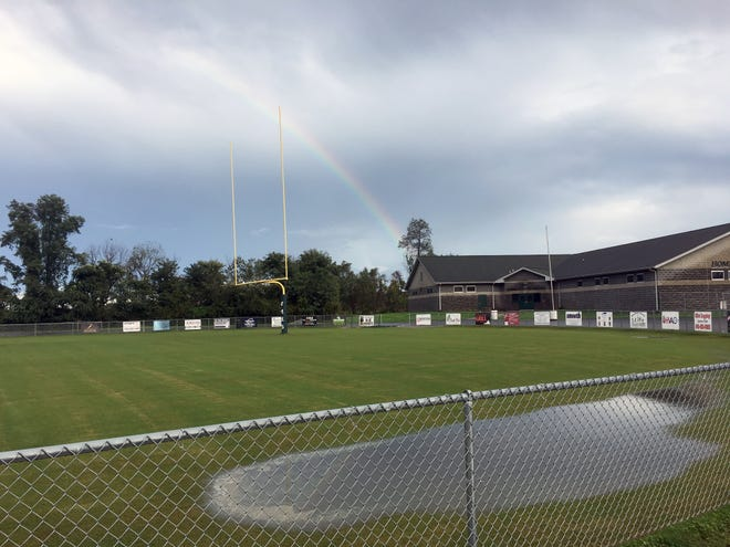 A rainbow arcs over the field house and one end of  Steve Geiman Stadium at Wilson Memorial High School after a thunderstorm on Wednesday, Sept. 26, 2018, in Fishersville Va.