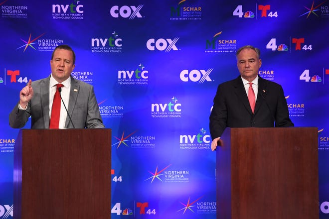 Republican Corey Stewart, left, responds to a question during the Virginia Senatorial Debate with Democrat Tim Kaine at Capital One Headquarters in McLean, Virginia, on Wednesday night.