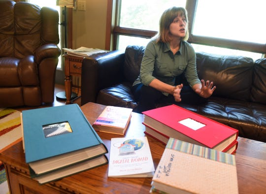 Maria Surma Manka talks about details involved in living and working abroad for several months at a time during an interview Wednesday, Sept. 26, at her home near Bowlus.