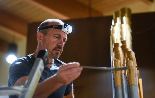 Brian Sullivan of the Obermeyer Organ Company concentrates while tuning the refurbished pipe organ Thursday, Sept. 27, at Salem Lutheran Church in St. Cloud.