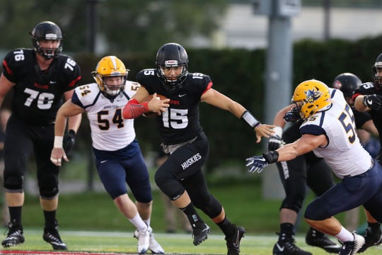 St. Cloud State quarterback Justin Czech (15) carries the ball in a game against Augustana on Sept. 23, 2017, at Husky Stadium. Czech came off the bench to help the Huskies to a 19-14 come-from-behind win at Northern State on Sept. 22, 2018.