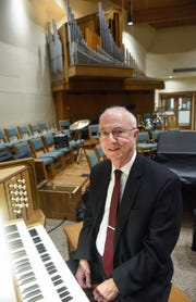 Organist Charles Echols is pictured at the keyboard of the refurbished organ Thursday, Sept. 27, at Salem Lutheran Church in St. Cloud.