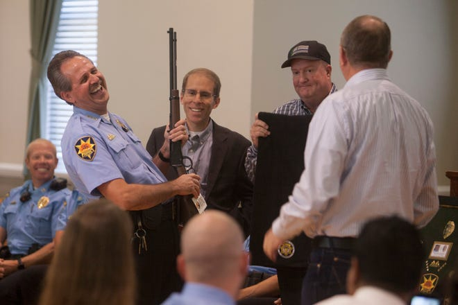 Friends and family gather to honor Chief Marlon Stratton as he retires after 34 years with the St. George Police Department Thursday, Sept. 27, 2018.