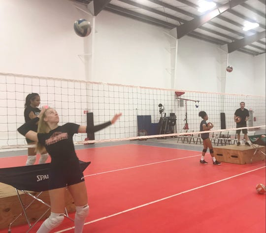 FAMU outside hitter Radka Dimitrova works with her teammates during practice.