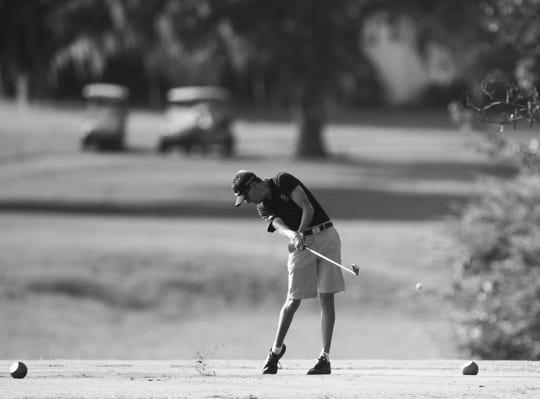 Florida High's Justus Jones tees off at the boys golf Big Bend Championship at Southwood Golf Club on Wednesday, Sept. 26, 2018.
