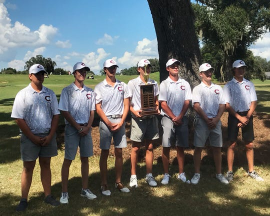 Chiles' boys golf team celebrates winning the Big Bend Championship at Southwood Golf Club, shooting 286 as a team to win by eight strokes over Maclay.