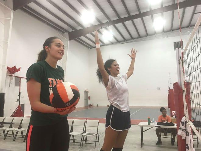 FAMU middle blockers Aybuke Kocabiyik and Karina Pressior cheer on their teammates during practice.