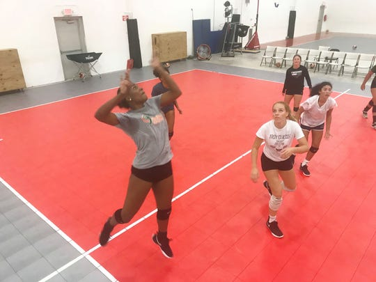 FAMU outside hitter María Yvett García leaps to return a serve during practices.