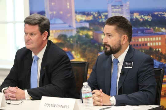 At the Tallahassee mayoral candidate debate,  candidates John Dailey (left) and Dustin Daniels (right) speak to the Tallahassee Democrat editorial board.