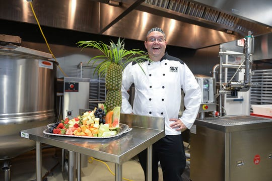 Chef Daniel Leavy is pleased with his fruit creation prepared in the teaching kitchen at the Treasure Coast Food Bank's Food Processing Plant.